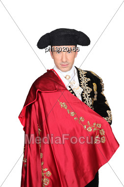Man In A Matador Costume With A Red Cape Stock Photo