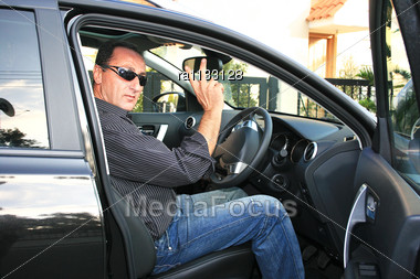 Man In New Black Car Stock Photo