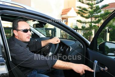 Man In New Black Car Stock Photo