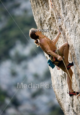 Man In Rock Climbing Stock Photo