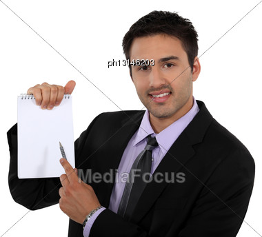 Man In Suit Pointing White Notebook Stock Photo