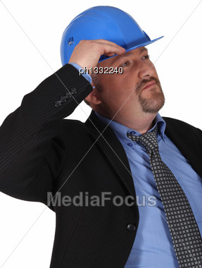 Man In Suit With Helmet Stock Photo