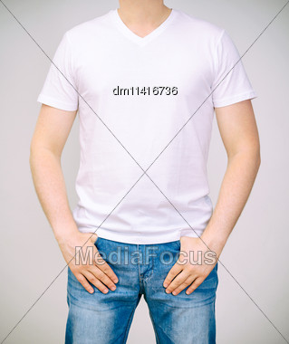Man In White T-shirt. Grey Background Stock Photo