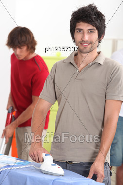 Man Ironing Shirt Stock Photo