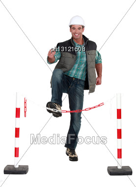 Man Jumping Over Security Chain Stock Photo
