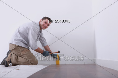 Man Laying Floorboards Stock Photo