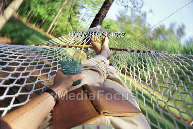man laying in hammock relaxing stock photo stock photo man laying in hammock relaxing   image novastock4652      rh   mediafocus
