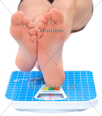 Man's Legs , Which Weighed On Floor Scale. Isolated Over White Stock Photo