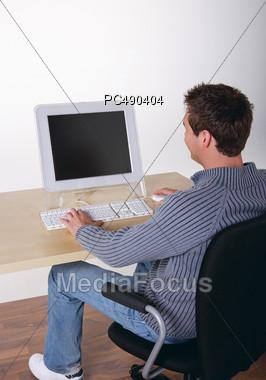 Man Looking at Computer Screen Stock Photo