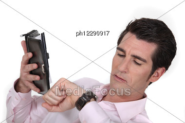 Man Looking At The Time Stock Photo