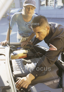 Man Looking At Car Engile For Female Customer Stock Photo