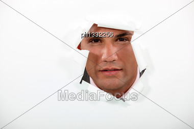 Man Looking Through A Hole Stock Photo