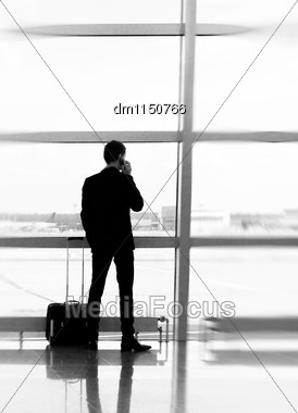 Man With Luggage In The Airport. Black And White Stock Photo
