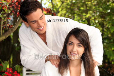 Man Massaging Woman Stock Photo