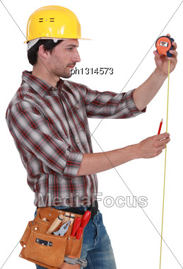Man Measuring Using Tape Measure Stock Photo