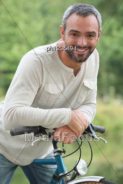 Man On Bike Ride Stock Photo