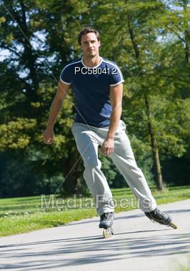 Man On Inline Skates Stock Photo