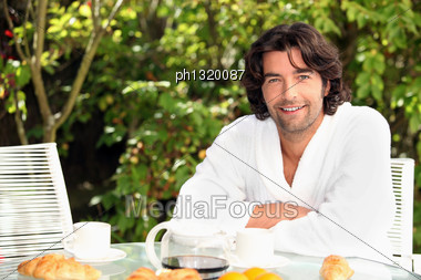 Man On Vacation Having His Breakfast Stock Photo