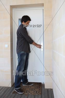Man Opening Door Stock Photo