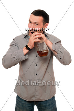 Man Opens A Bottle Of Whiskey. Stock Photo