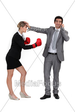 Man On The Phone And Woman With Boxing Gloves Stock Photo