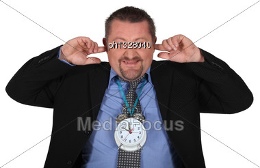Man Plugging His Ears Stock Photo