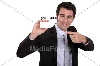 Man Pointing At Business Card Stock Photo