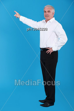 Man Pointing To An Invisible Object Stock Photo