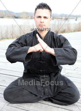 Man Practising Martial Arts Outdoors Stock Photo