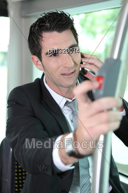 Man Pressing Stop Bell On A Tram Stock Photo