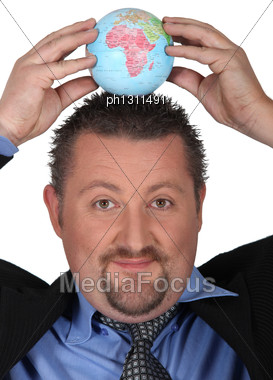 Man Putting A Globe On Head Stock Photo