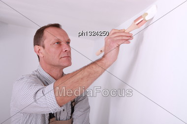 Man Repainting Home Walls Stock Photo