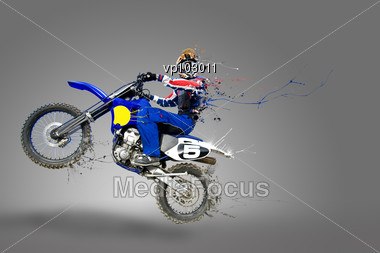 Man Riding His Motocross Bike With Paint Detaching All Over His Bike And Body Stock Photo