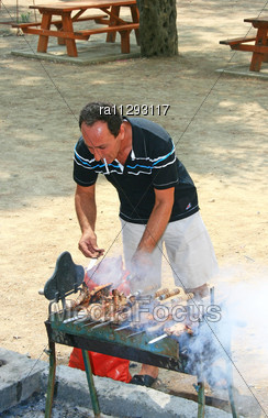 Man Roasted Barbecue On The Charcoal Stock Photo