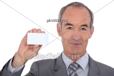Man Showing Businesscard Stock Photo