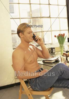 Man Sitting Making Phone Call Stock Photo