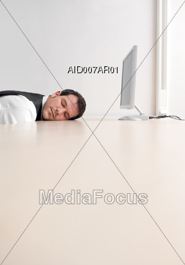 Man Sleeping in Front of Computer Stock Photo