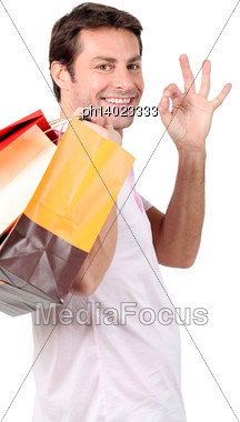 Man Smiling With Shopping Bags Stock Photo