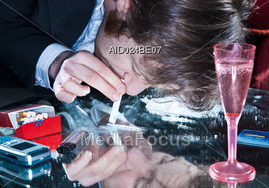 Man Sniffing Cocaine Stock Photo