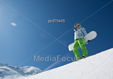 Man With Snowboard at top of Halfpipe Stock Photo