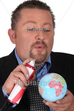 Man Spraying Globe Stock Photo
