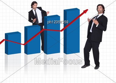 Man Stood By Graph Stock Photo