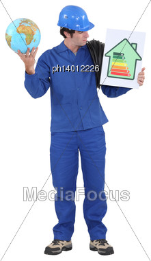 Man Stood With Globe And Energy Efficiency Logo Stock Photo