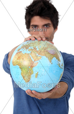Man Stood With Globe Stock Photo