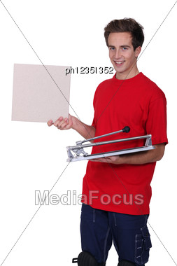 Man Stood With Tile Cutter Stock Photo
