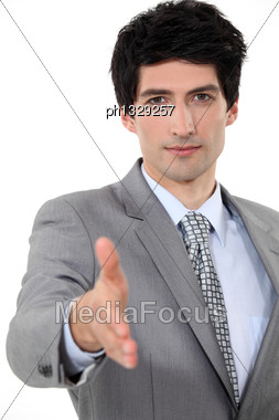 Man Stretching Hand For Greeting Stock Photo