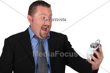 Man Stunned At Alarm Clock Stock Photo