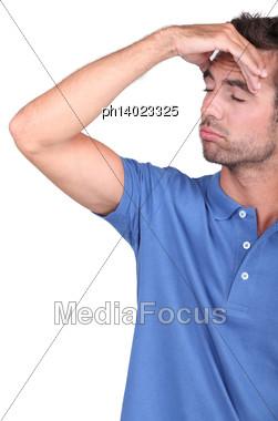 Man Suffering From Headache Stock Photo