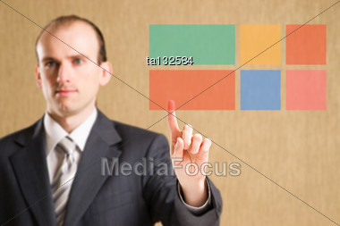 Man In Suit Clicking On Flat Interface Button Stock Photo