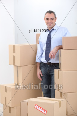 Man Surrounded By Boxes Stock Photo